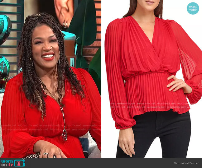 Pleated Wrap Top by DKNY worn by Kym Whitley  on E! News