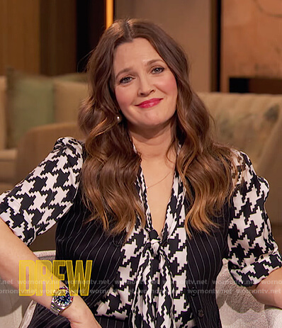 Drew's houndstooth print tie neck blouse on The Drew Barrymore Show