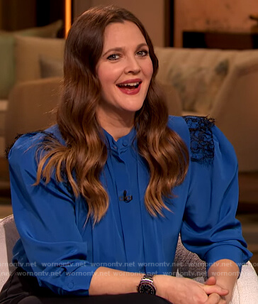 Drew's blue lace trim tie neck blouse on The Drew Barrymore Show