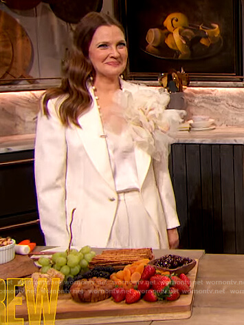 Drew's white blazer and pants on The Drew Barrymore Show