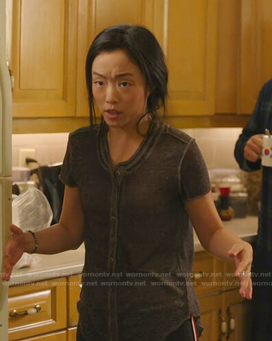 Janet's black henley tee on Kims Convenience