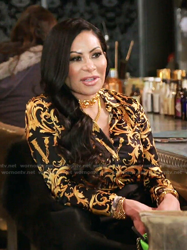 Jen's black and yellow printed shirt on The Real Housewives of Salt Lake City