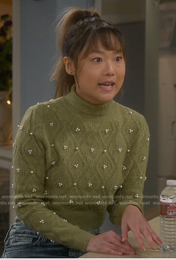 Jen's green pointelle sweater with pearls on Last Man Standing