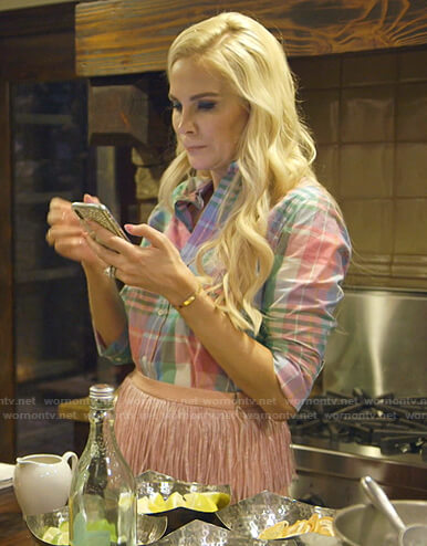 Kameron's pink plaid shirt and fringed skirt on The Real Housewives of Dallas