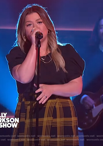 Kelly's yellow and black plaid skirt on The Kelly Clarkson Show