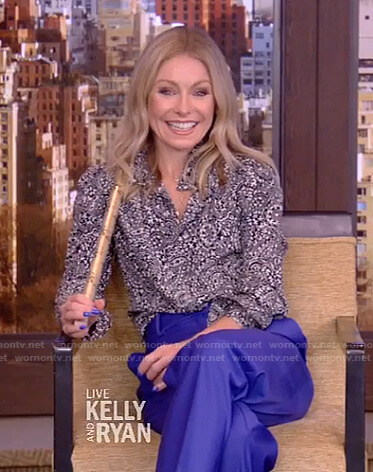 Kelly's black paisley blouse and blue pants on Live with Kelly and Ryan