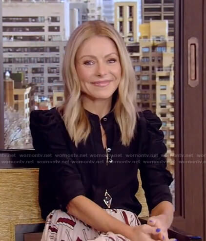 Kelly's black puff sleeve blouse and print pleated skirt on Live with Kelly and Ryan