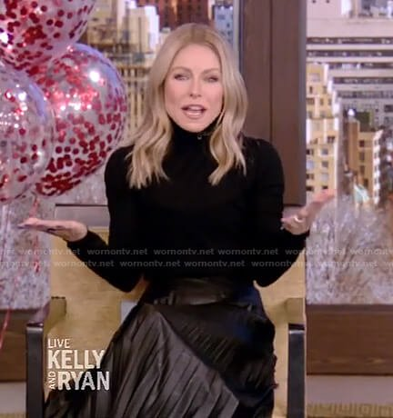 Kelly's black turtleneck sweater and pleated skirt on Live with Kelly and Ryan