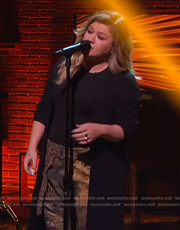 Kelly's mixed camo and leopard print cargo pants on The Kelly Clarkson Show