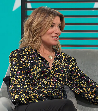 Kit's black and yellow floral blouse on Access Hollywood