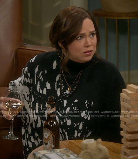 Kristin's black splatter print turtleneck sweater on Last Man Standing