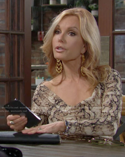 Lauren's snake print long sleeved dress on The Young and the Restless