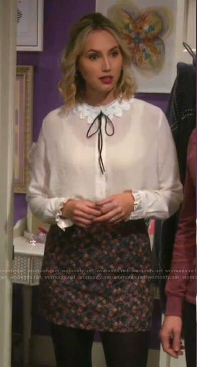 Mandy's white lace collar blouse and floral skirt on Last Man Standing