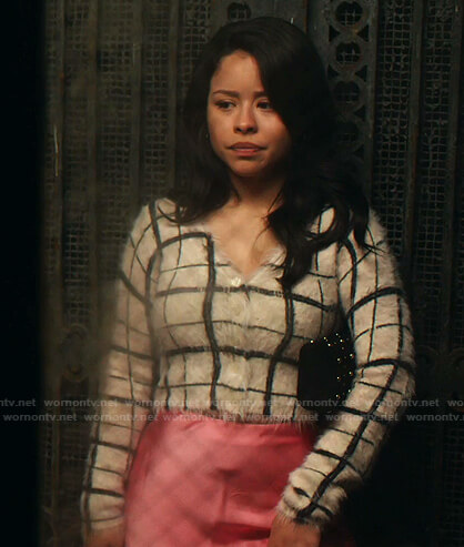 Mariana's white check sweater and pink skirt on Good Trouble