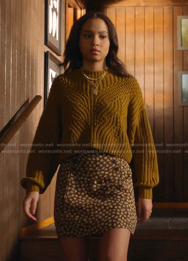 May's yellow ribbed sweater and brown floral skirt on 9-1-1