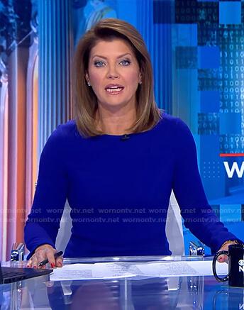 Norah's blue side slit sheath dress on CBS Evening News