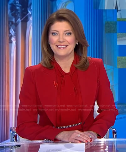 Norah's red chain embellished blazer on CBS Evening News
