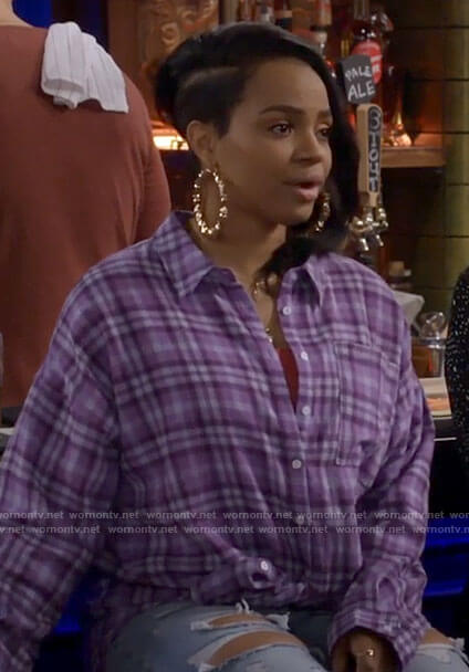 Randi's purple plaid shirt with OVERDRESSED on the back