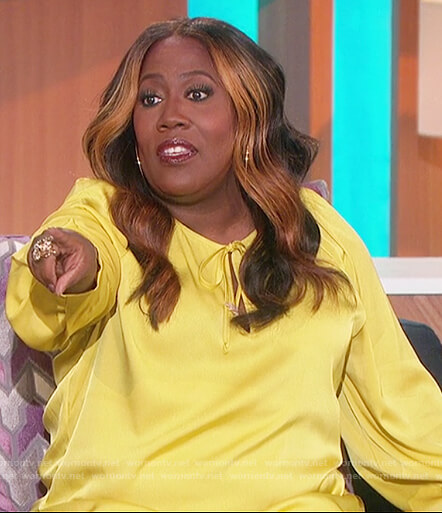 Sheryl's yellow satin tie neck blouse on The Talk
