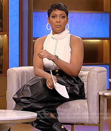 Tamron's white lace inset top and leather pants on Tamron Hall Show
