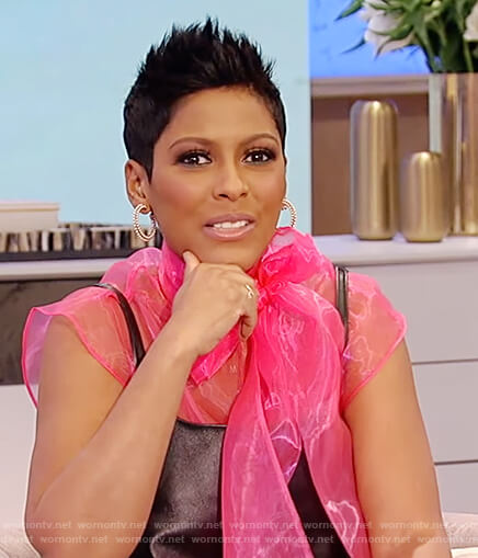 Tamron's black leather dress and pink tulle top on Tamron Hall Show