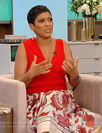 Tamron's red twist front top and printed floral skirt on Tamron Hall Show