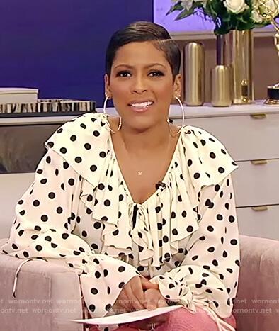 Tamron's white polka dot ruffle blouse on Tamron Hall Show