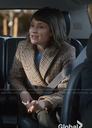 Taylor's beige checked coat on Bull