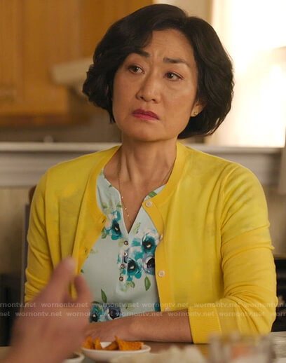Mrs. Kim's green floral henley top on Kims Convenience