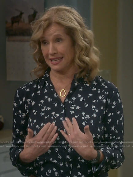 Vanessa's navy floral button down top on Last Man Standing