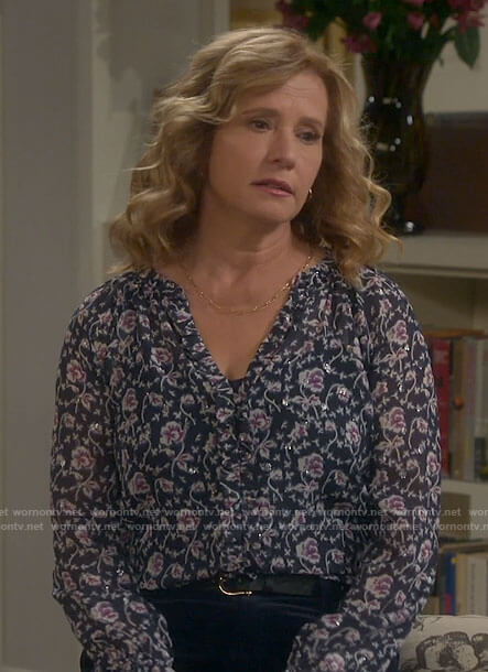 Vanessa's navy floral metallic blouse on Last Man Standing