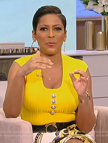 Tamron's yellow button embellished top on Tamron Hall Show