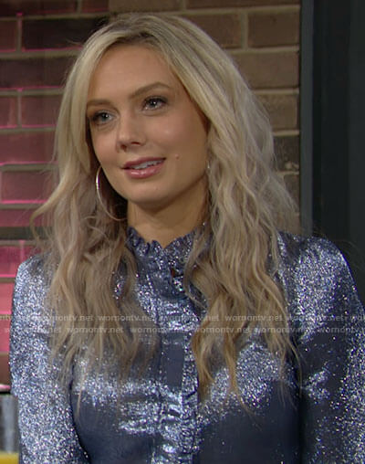 Abby's blue metallic blouse with ruffled trim on The Young and the Restless