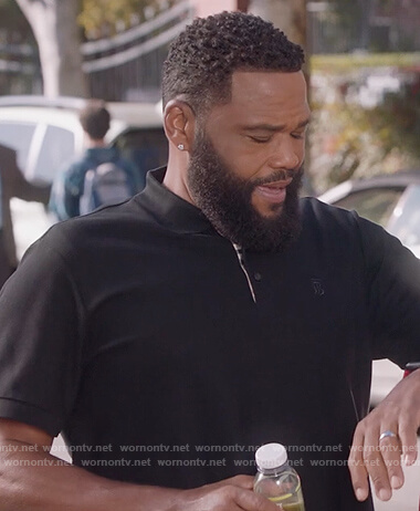 Andre's black polo shirt on Black-ish