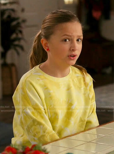 Anna's yellow tie dye sweatshirt on American Housewife