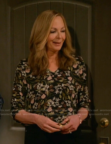 Bonnie's black floral v-neck top on Mom