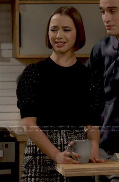 Celia's black puff sleeve top and houndstooth skirt on Call Your Mother