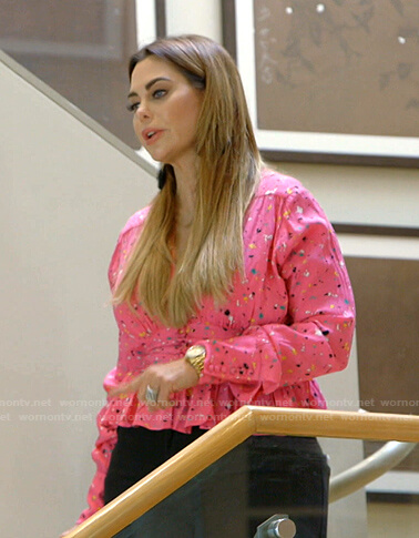 D'Andra's pink printed peplum top on The Real Housewives of Dallas