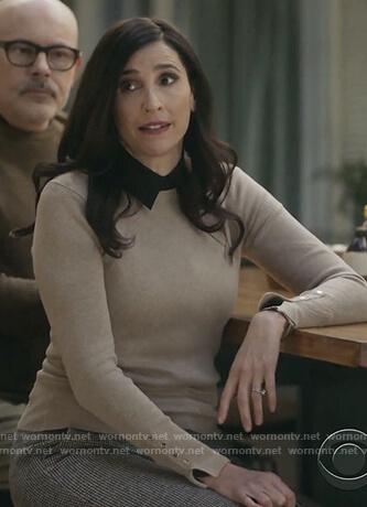 Delia's beige button cuff sweater on The Unicorn
