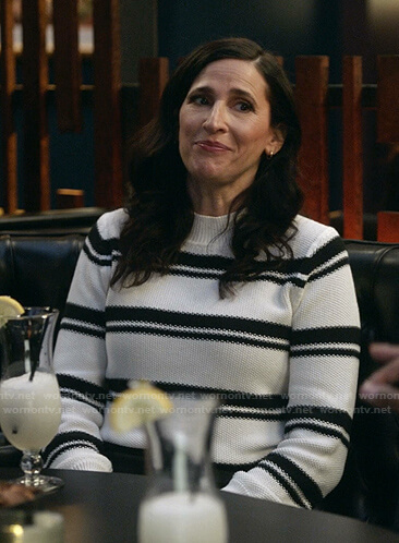 Delia's black and white striped knit sweater on The Unicorn