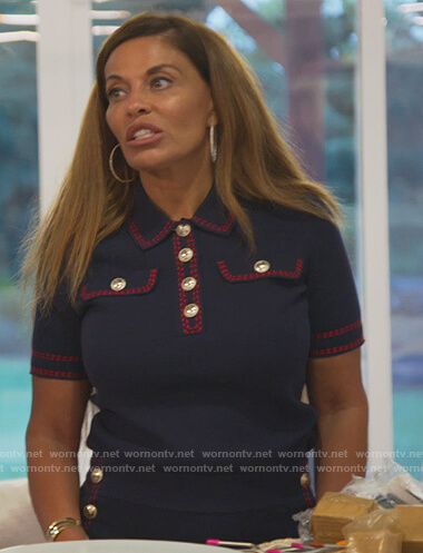 Dolores's navy contrast stitch polo and shorts on The Real Housewives of New Jersey