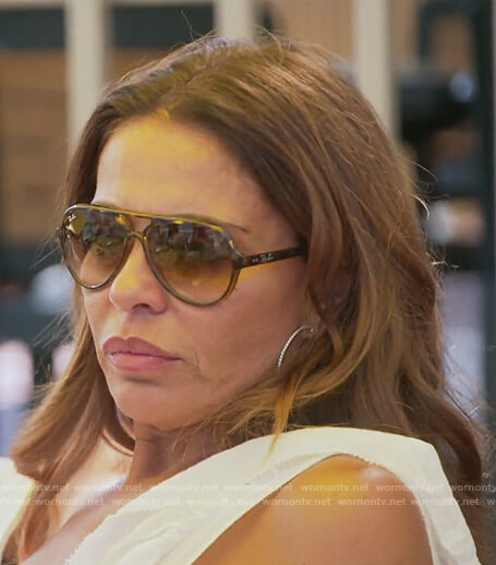 Dolores's brown sunglasses on The Real Housewives of New Jersey
