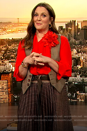 Drew's orange tie neck blouse and plaid skirt on The Drew Barrymore Show