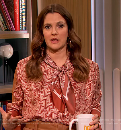 Drew's red printed tie neck blouse on The Drew Barrymore Show