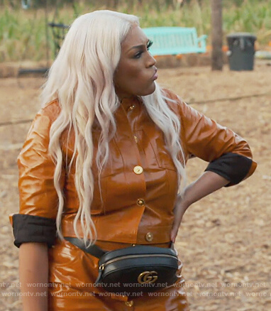 Drew's orange leather button jacket and skirt on The Real Housewives of Atlanta