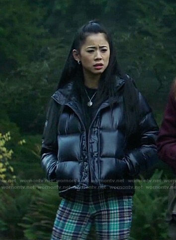 George's black puffer jacket and green plaid pants on Nancy Drew