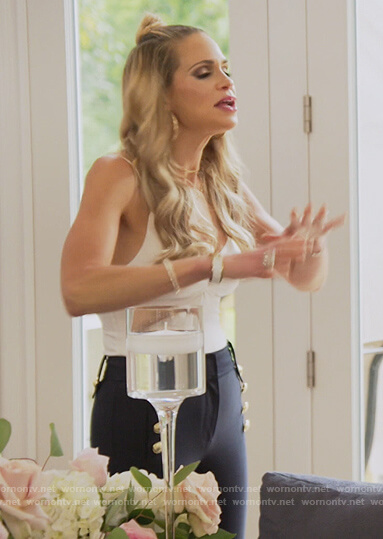 Jackie's black pants with gold buttons on The Real Housewives of New Jersey