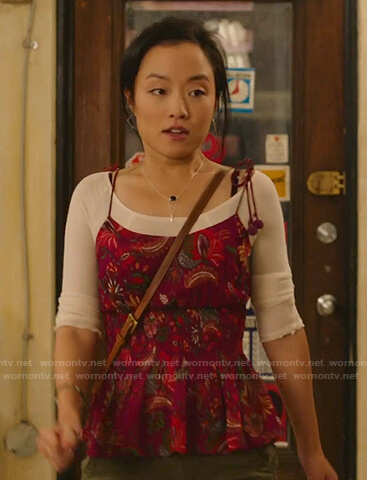 Janet's burgundy floral peplum camisole on Kims Convenience