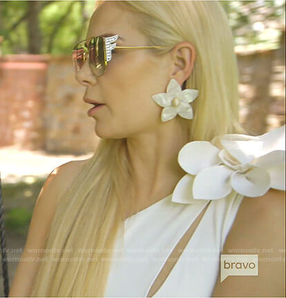 Kameron's white one-shoulder swimsuit and sunglasses on The Real Housewives of Dallas
