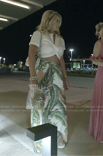Kary's white cropped top and pineapple print pants on The Real Housewives of Dallas